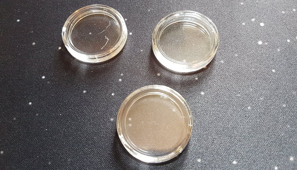 Scratched coin capsules