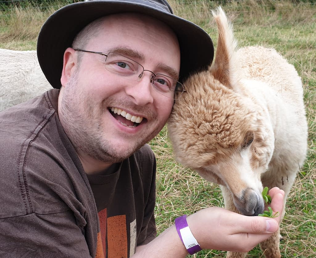 Me feeding an alpaca